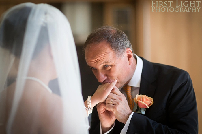 father of the bride reacts to seeing his daughter in her wedding dress